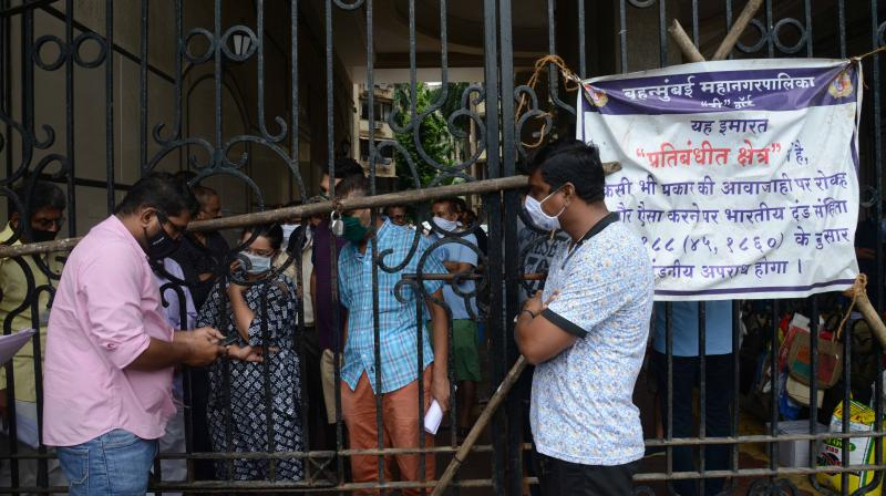 Residents of Navjivan Cooperative Housing Society negotiate with civic staff at one of the gates to their complex. (AA Photo: Rajesh Jadhav)