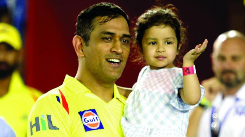 CSK skipper M.S. Dhoni with his daughter Ziva at the post match ceremony. (Photo: BCCI)