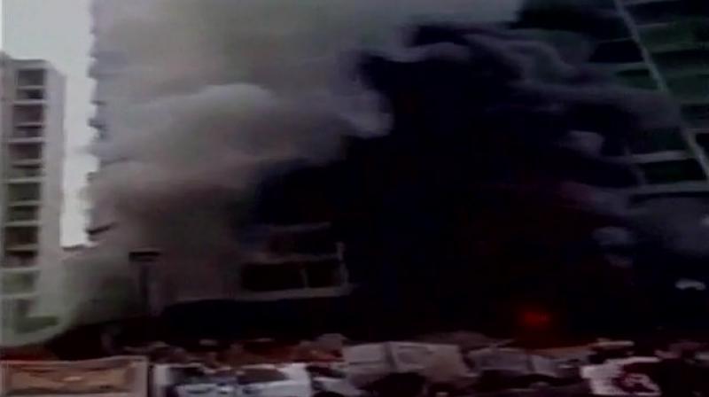 Fire at the car showroom in Navi Mumbai. (Photo: Twitter | ANI)