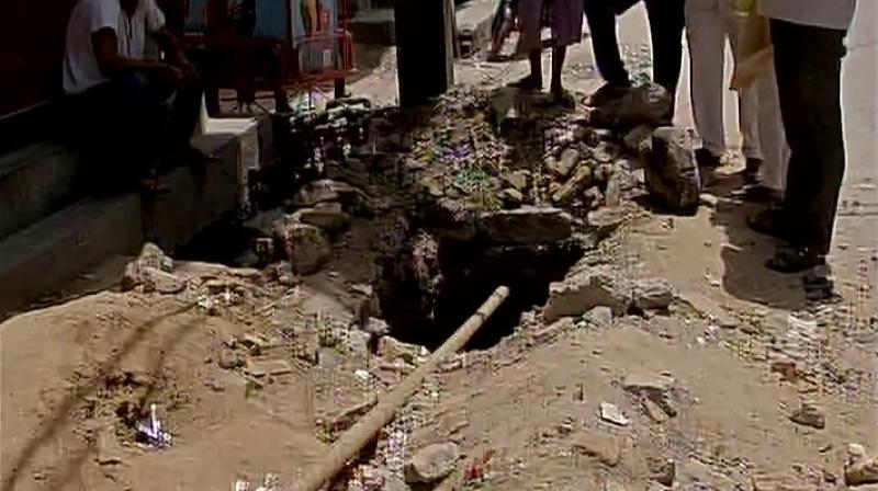 Man dies after falling into deep pit allegedly dug by BSES to lay cables in Delhi. (Photo: Twitter | ANI)