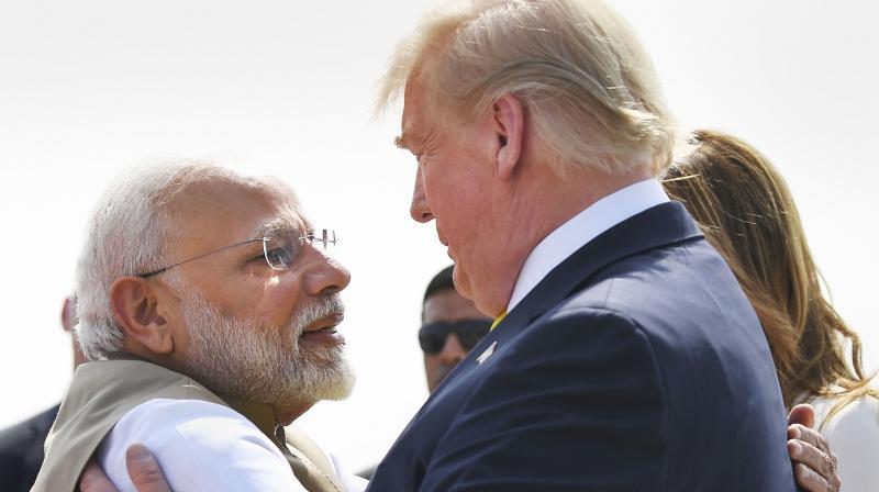 Prime Minister Narendra Modi warmly hugs US President Donald Trump upon the latter's arrival at the Sardar Vallabhbhai Patel International Airport in Ahmedabad, Feb. 24, 2020. (PTI)
