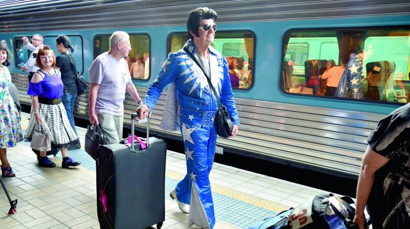 Elvis fans board a train to take them to The Parkes Elvis Festival from Sydney on Thursday. (Photo: AFP)