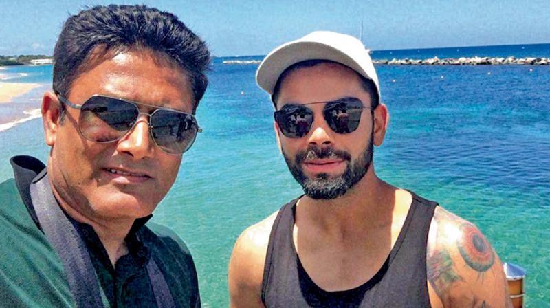 Anil Kumble (left) and Virat Kohli.