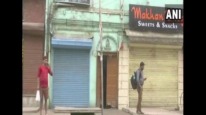 Despite a day's business loss, traders express their grief with a complete shut down over the loss of so many soldiers in a gruesome terror attack. (Photo: ANI)