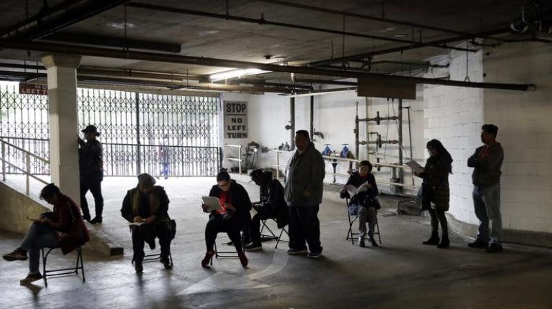 People waiting to file for unemplyement benefits. (Photo- AP)