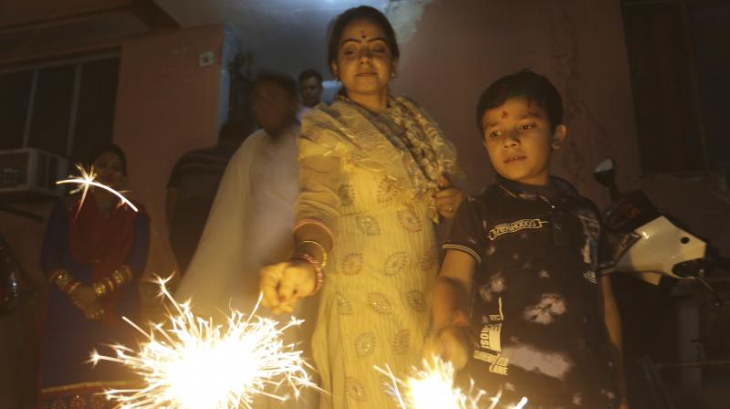 Diwali, the Hindu festival of lights, was celebrated across the country Thursday. The festival marks the triumph of light over darkness, the return of Lord Rama and in certain parts of India, the invocation of Goddess Kali. (Photo: PTI. AP)