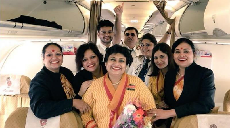 A photograph of Pooja Chinchankar on her last flight as an air hostess with Air India. (Photo: Twitter | @caramelwings)