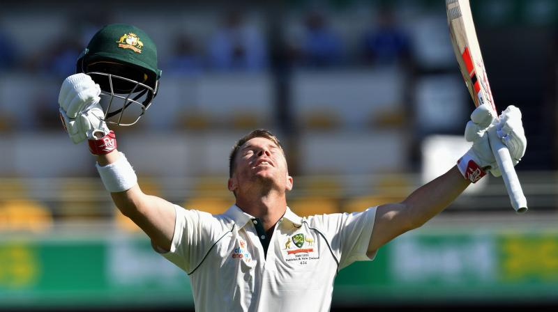 Australia opener David Warner enjoyed a measure of redemption as he scored his first Test century since a year-long ban for ball-tampering on Friday. (Photo:AFP)