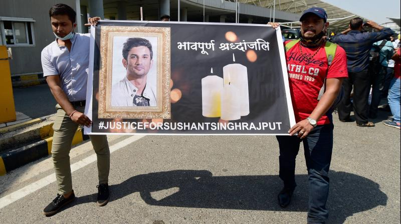 Sushant Singh Rajput's aides stage a demonstration demanding justice for the late actor, outside the airport in New Delhi. — PTI photo