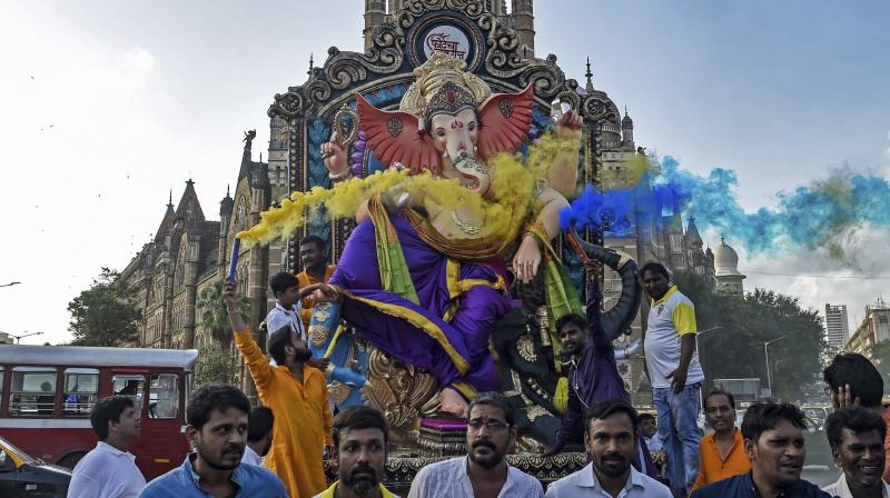 Lord Ganesha is elephant-headed son of Lord Shiva and Goddess Parvati and is considered as symbol of wisdom, prosperity and good fortune. (Photos: PTI, AP)