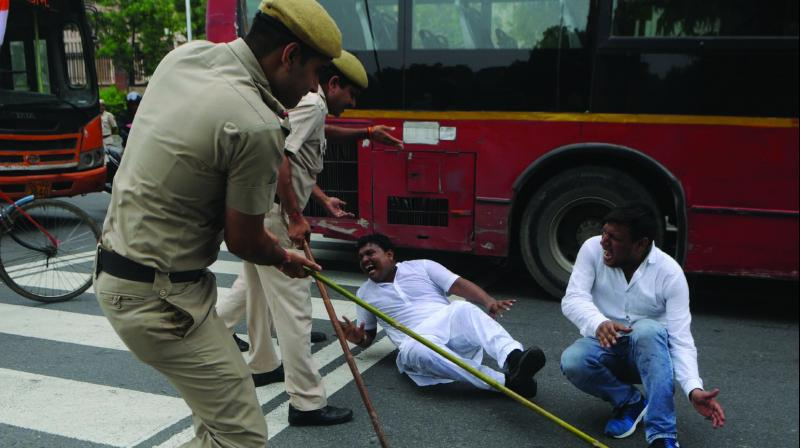 Policemen lathicharge on members of Indian Youth Congress in New Delhi on Monday during the 'Bharat Bandh' called against fuel price hike and depreciation of the rupee. (Photo: Biplab Banerjee)