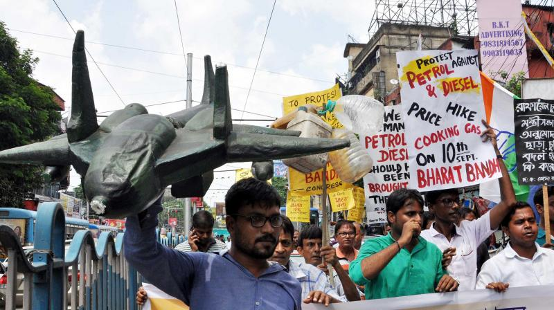 """State Congress activists protest against petrol price hike, Rafale scam and other issues as the rally in support of the """"Bharat Bandh"""" at Hazra crossing in Kolkata on Monday. (Photo: Abhijit Mukherjee)"""