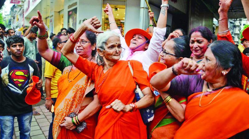 Shiv Sena workers celebrate the party's stellar performance in the Maharashtra Assembly polls, at Dadar in Mumbai. (Photo: Shripad Naik)