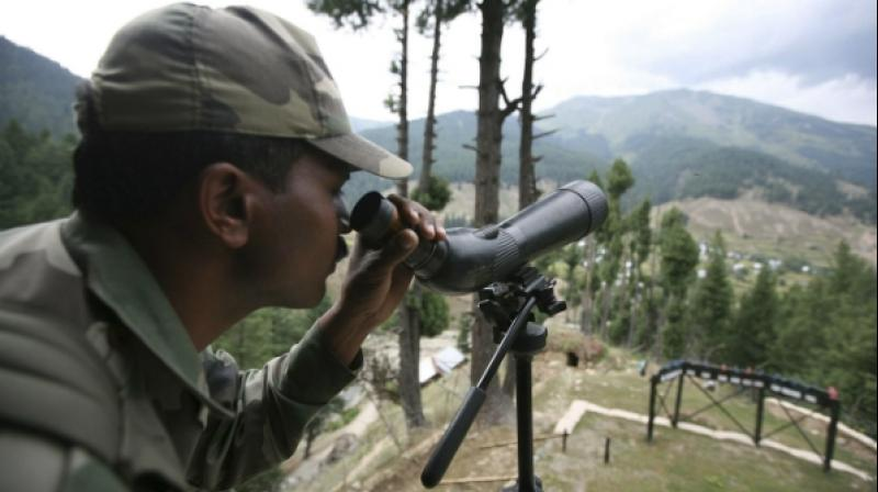 A soldier on guard near the Line of Control in Jammu and Kashmir. (Photo: PTI)