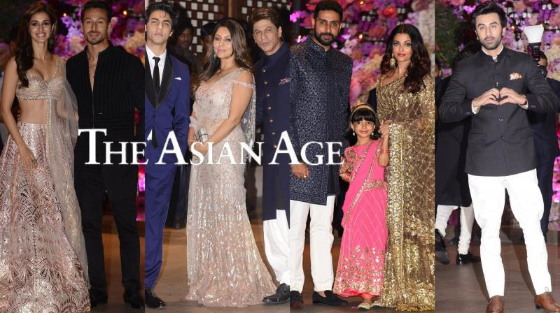 Nita and Mukesh Ambani hosted a grand engagement party for their elder son Akash Ambani and Shloka Mehta at their Mumbai home on Saturday evening. The starry guest list included Bollywood's who's who from Shah Rukh-Gauri Khan and their son Aryan Khan, Aamir Khan and wife Kiran Rao, Abhishek Bachchan and Aishwarya Rai Bachchan with their daughter Aaradhya, Ranbir Kapoor, mother Neetu Kapoor, filmmaker Ayan Mukerji, Rekha, Kajol, Tiger Shroff-Disha Patani, Alia Bhatt, Madhuri Dixit-Nene among many other top celebs. (Photos: Viral Bhayani)