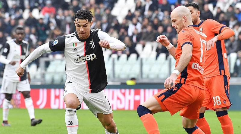 Cristiano Ronaldo scored twice as Juventus beat Udinese 3-1 to join Inter Milan at the top of the Serie A table after Antonio Conte's side were held 1-1 at Fiorentina. (Photo:AP)