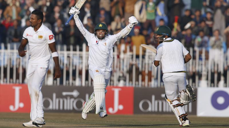 Pakistan's record breaking batsman Abid Ali on Sunday said that it was a magic moment for him to score a Test century on debut against Sri Lanka here in the country's first home match in the long form of the game in 10 years. (Photo:AP)