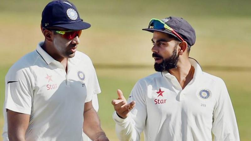 Ravichandran Ashwin and Virat Kohli during the first Test against Australia in Pune. (Photo: PTI)