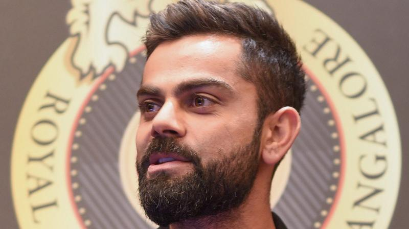 Kohli, captain of RCB, was attending an event along with Ashish Nehra and RCB coach Gary Kirsten to launch an RCB App. (Photo: PTI)