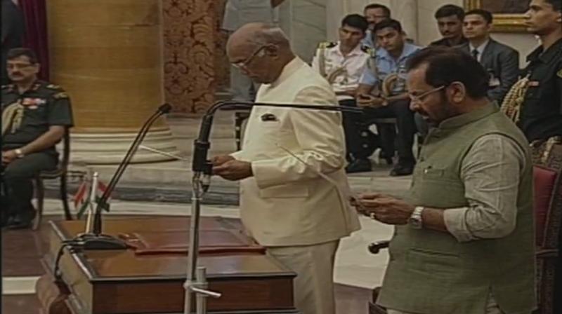 President Ram Nath Kovind swears in Union Minister Mukhtar Abbas Naqvi. (Photo: Twitter | ANI)
