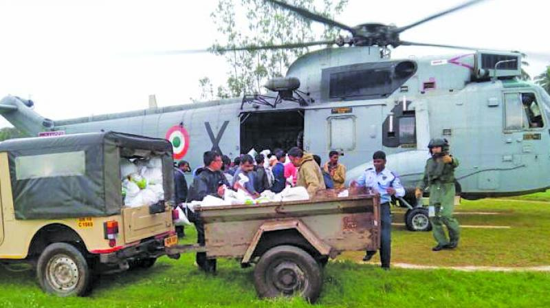 Food packets being loaded into a copter. (Photo: Asian Age)