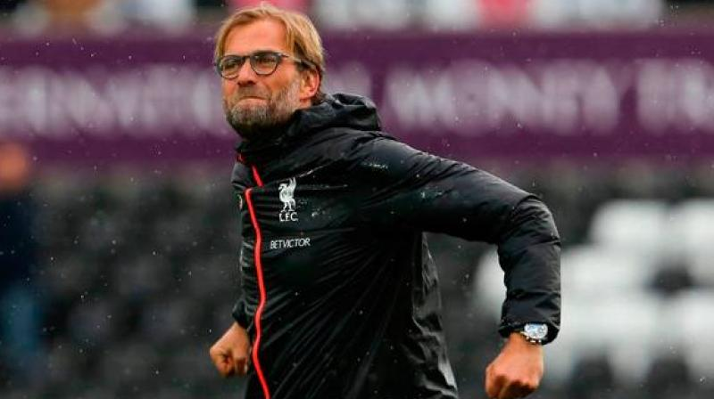 Liverpool coach Juergen Klopp was awarded the Best FIFA Men's Coach of the Year on Monday (local time) at The Best FIFA Football Awards ceremony in Milan. (Photo:AFP)