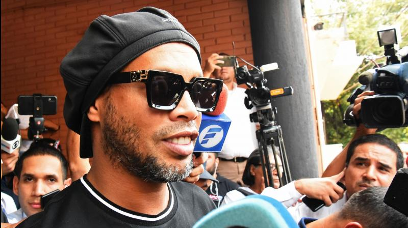 Brazilian retired footballer Ronaldinho leaves Asuncions Prosecution after declaring about his irregular entry into the country, in Asuncion, Paraguay, on Thursday. AFP Photo