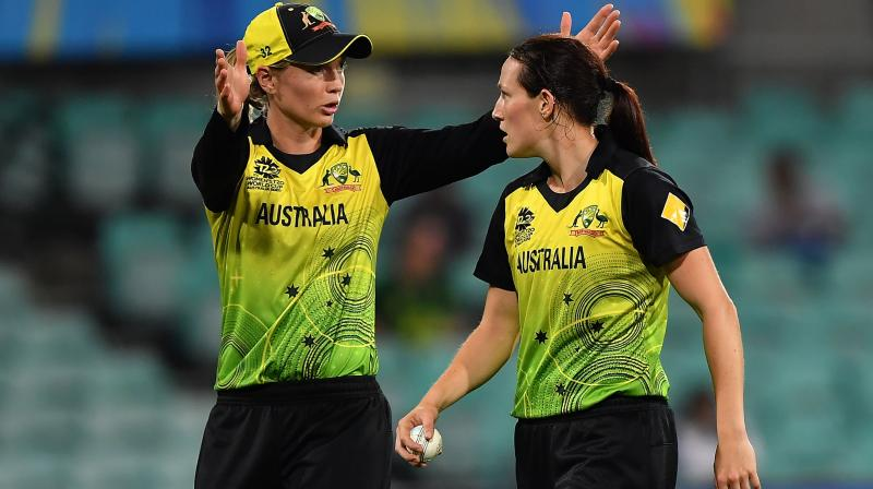 Megan Schutt (right) receiving instructions from her skipper Rachael Haynes during a T20 World Cup match in Sydney. AFP Photo