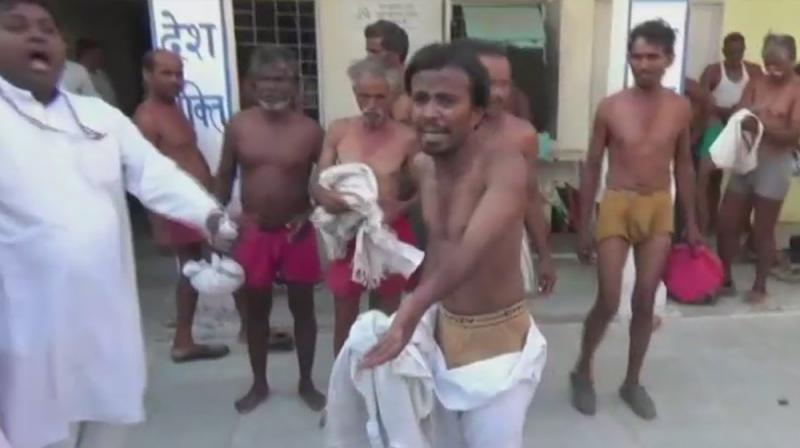 Protesting farmers allegedly stripped and thrashed by Police in Madhya Pradesh's Tikamgarh. (Photo: ANI/Twitter)