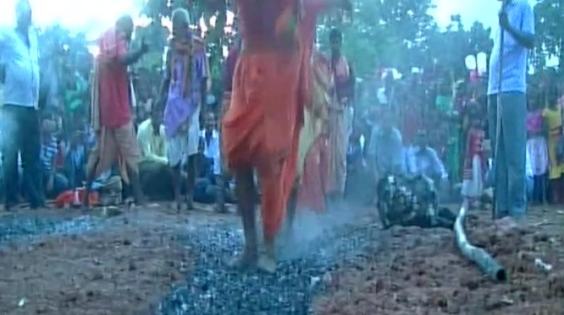 In a remote place named Bhanjakia of Raruan block of Mayurbhanj district, which is in the foot place of the Similipal forest, local tribal people demonstrate their beliefs and devotions in a self torturing way. (Photo: ANI)