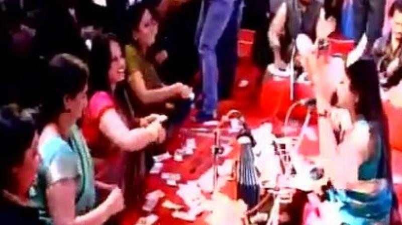 Residents in Gujarat's Navsari district showered Rs. 40 lakh on folk singers during a musical event. (Photo: ANI/Twitter)
