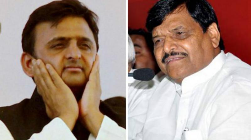 Uttar Pradesh Chief Minister Akhilesh Yadav and Samajwadi Party leader Shivpal Yadav. (Photos: PTI/File)