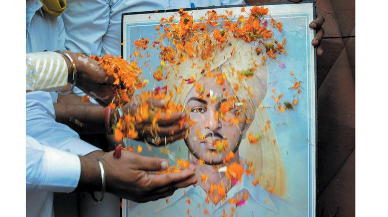 Members of All-India Anti-Terrorist Front pay tribute to Shaheed Bhagat Singh on his 87th martyrdom day, at Jallianwala Bagh in Amritsar. (Photo: PTI)
