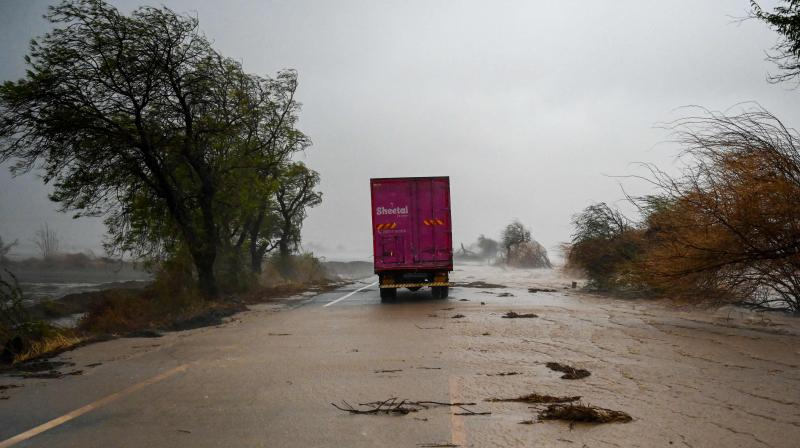 A truck is stranded on a flooded highway near Diu on May 18, 2021, after Cyclone Tauktae blasted ashore in western India late May 17 with fierce winds and drenching rains that turned streets into rivers, disrupting the country's response to its devastating Covid-19 outbreak. (Punit PARANJPE / AFP)