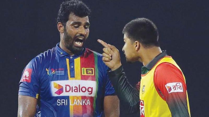 Bangladesh reserve Nurul Hasan points a finger at Sri Lanka captain Thisara Perera. (Photo: AP)