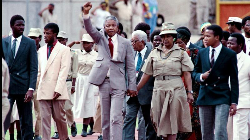 Most of Winnie Mandela's 38-year marriage to Nelson was spent apart, leaving her to raise their two daughters alone as she kept his political dream alive. (Photo: AFP)