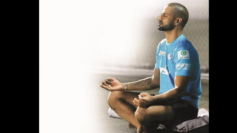 Shikhar Dhawan  meditating  during one of his yoga sessions