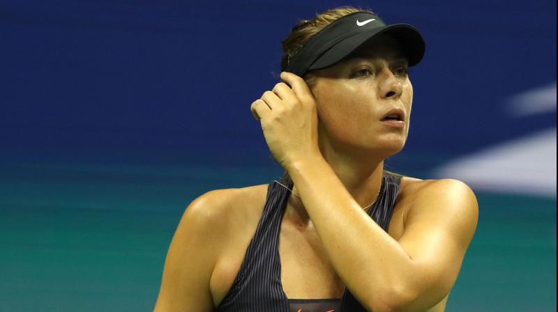 Maria Sharapova slipped back into an all-too-familiar routine on Monday as the Russian came up short for the 20th time in 22 matches against Serena Williams to exit the US Open in the first round. (Photo:AFP)