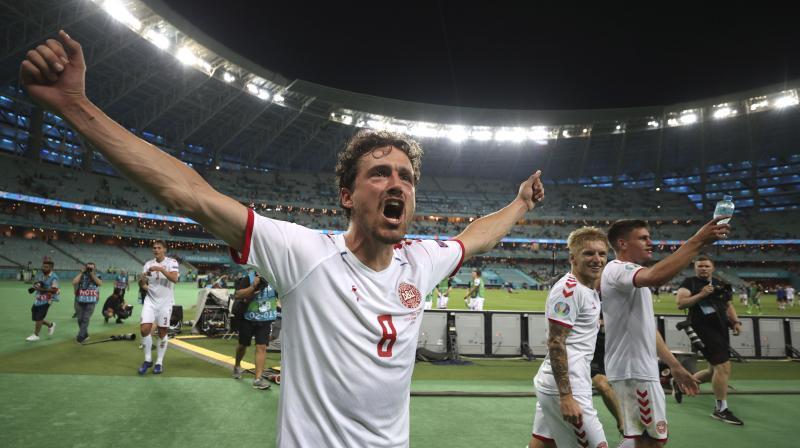 Denmark's Thomas Delaney celebrates their 2-1 win in the quarterfinal match against Czech Republic in Baku on Saturday. (Photo: AP)