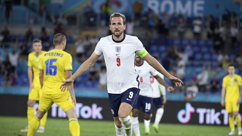 England's Harry Kane celebrates after scoring his side's third goal during their quarterfinal match against Ukraine in Rome on Saturday. (Photo: AP)