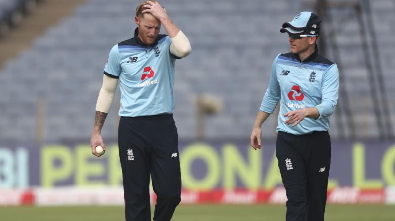 Ben Stokes (left) will take over the England captaincy from Eoin Mogan (right) in his absence. (Photo: AP)