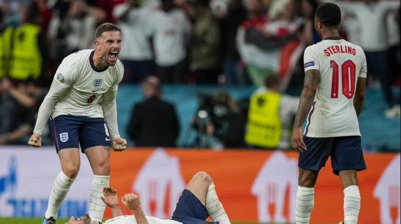 England players celebrate after winning the Euro 2020 semifinal match against Denmark in London on Wednesday. (Photo: AP)