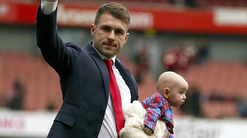 Ramsey, who is the club's highest scoring central midfielder with 64 goals, was given a guard of honour by his team mates and presented with a memento after Arsenal's 1-1 draw with Brighton and Hove Albion at the Emirates Stadium. (Photo: AP)
