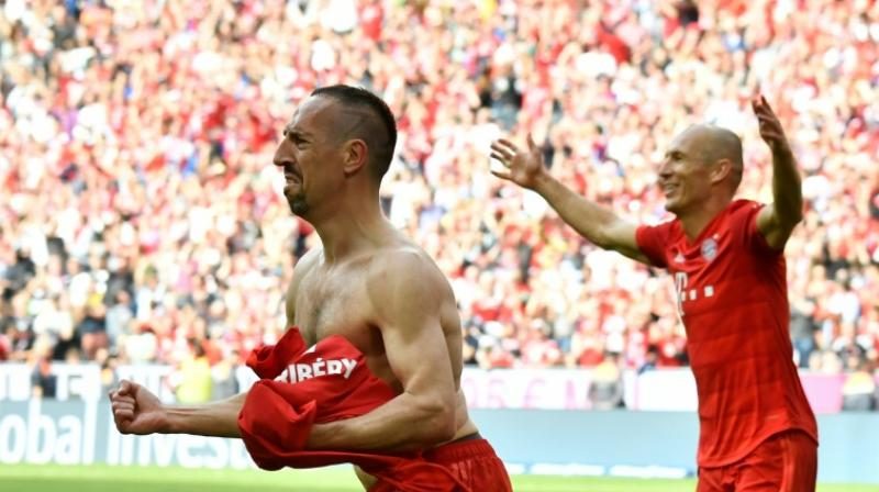 The star pair of Ribery and Robben played their final match for the club on Saturday and both these footballers scored for Munich, ensuring team's 5-1 win in the finals over Eintracht Frankfurt. (Photo: AFP)