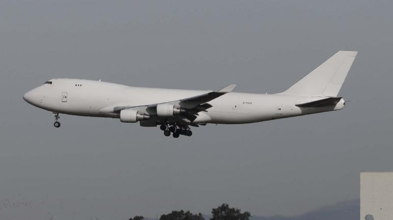 A plane carrying evacuees from the virus zone in China lands at Marine Corps Air Station Miramar Wednesday. PTI image