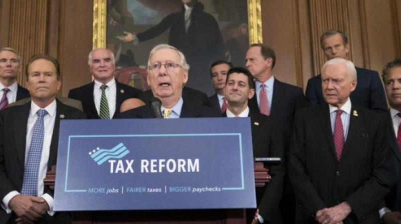 Mr Trump himself complained in a tweet that 'defeated Dems' and the media were out to 'demean' the tax package but 'the results will speak for themselves, starting very soon.' (Photo: