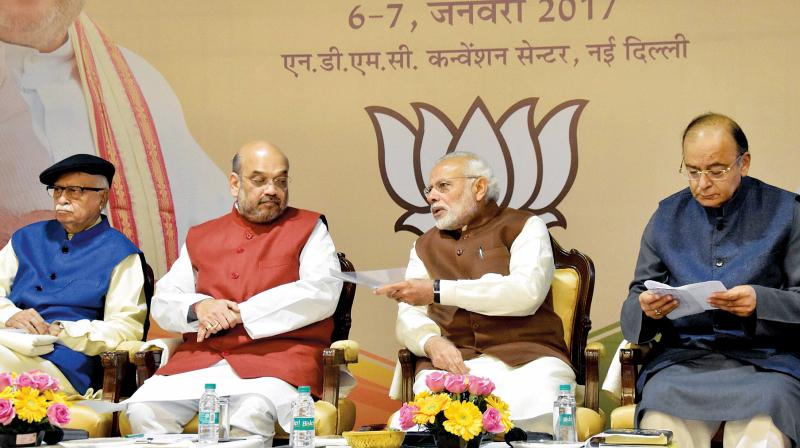 (From left) BJP patriarch L.K. Advani, party president Amit Shah, PM Narendra Modi and finance minister Arun Jaitley on the second and concluding day of the party's national executive meeting. (Photo: PTI)