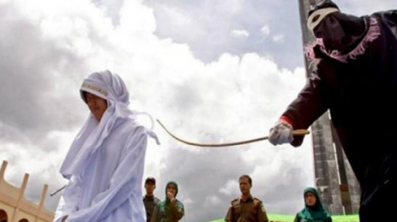 Woman being lashed for a crime committed under Sharia law. (Photo: AP)