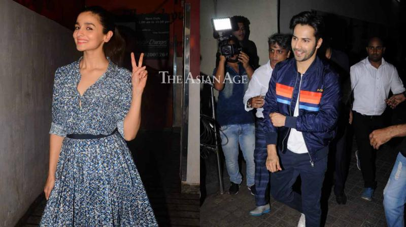 Varun Dhawan and Alia Bhatt were all excited as they welcomed Bollywood stars for a screening of the film. (Photo: Viral Bhayani)