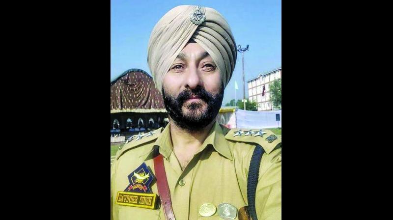 Suspended policeman Davinder Singh.